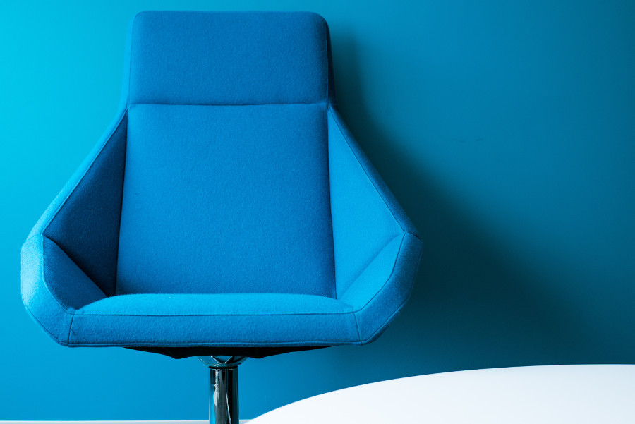blue therapy chair against a wall